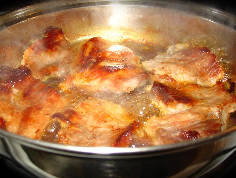 Friptura de porc cu ciuperci in sos picant